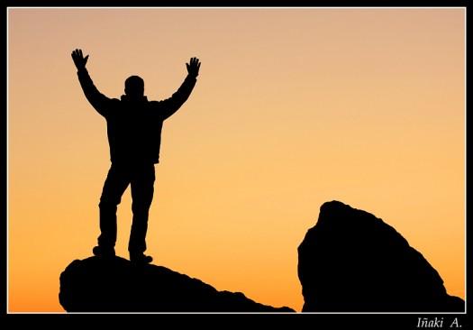 man silhouette on rocks
