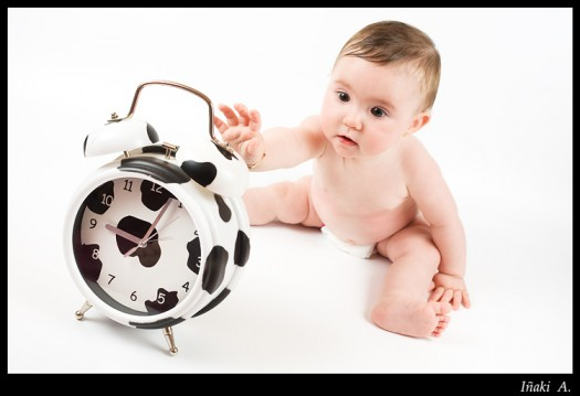 Baby with cow clock.